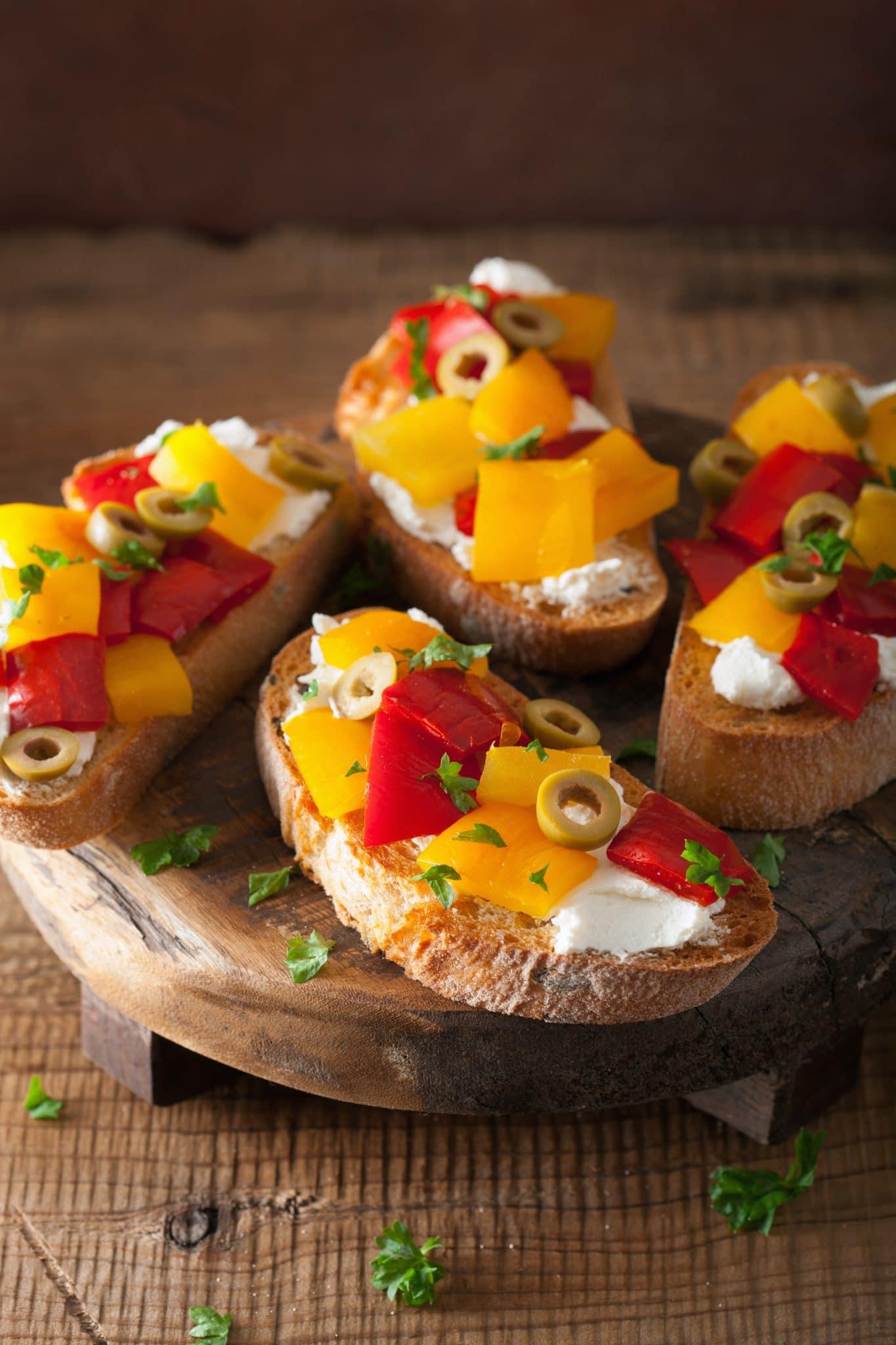 italian-bruschetta-with-peppers-goat-cheese-PHMHR7U